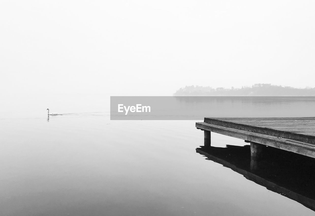 water, fog, tranquility, tranquil scene, beauty in nature, lake, scenics - nature, waterfront, sky, nature, pier, reflection, no people, copy space, day, non-urban scene, idyllic, outdoors