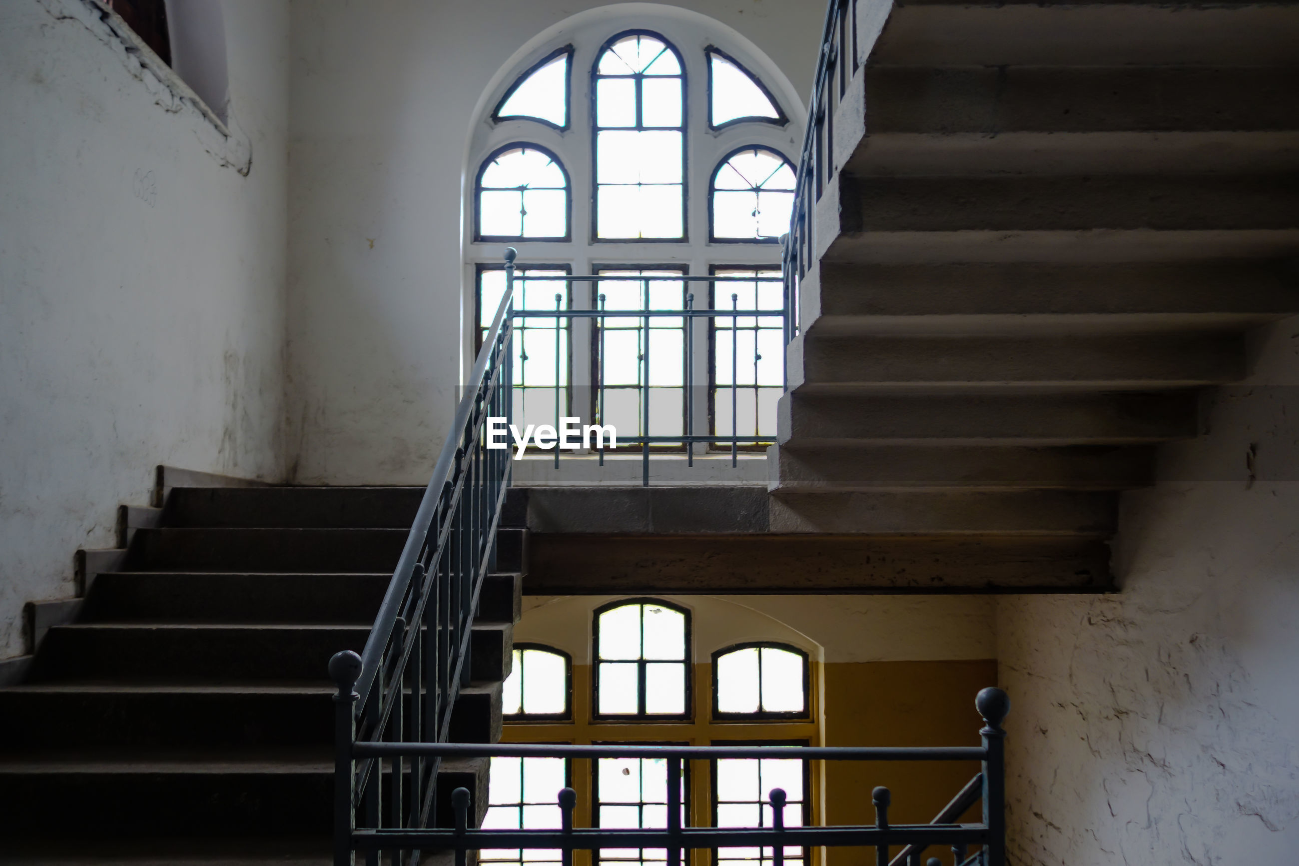 Low angle view of stairs against windows