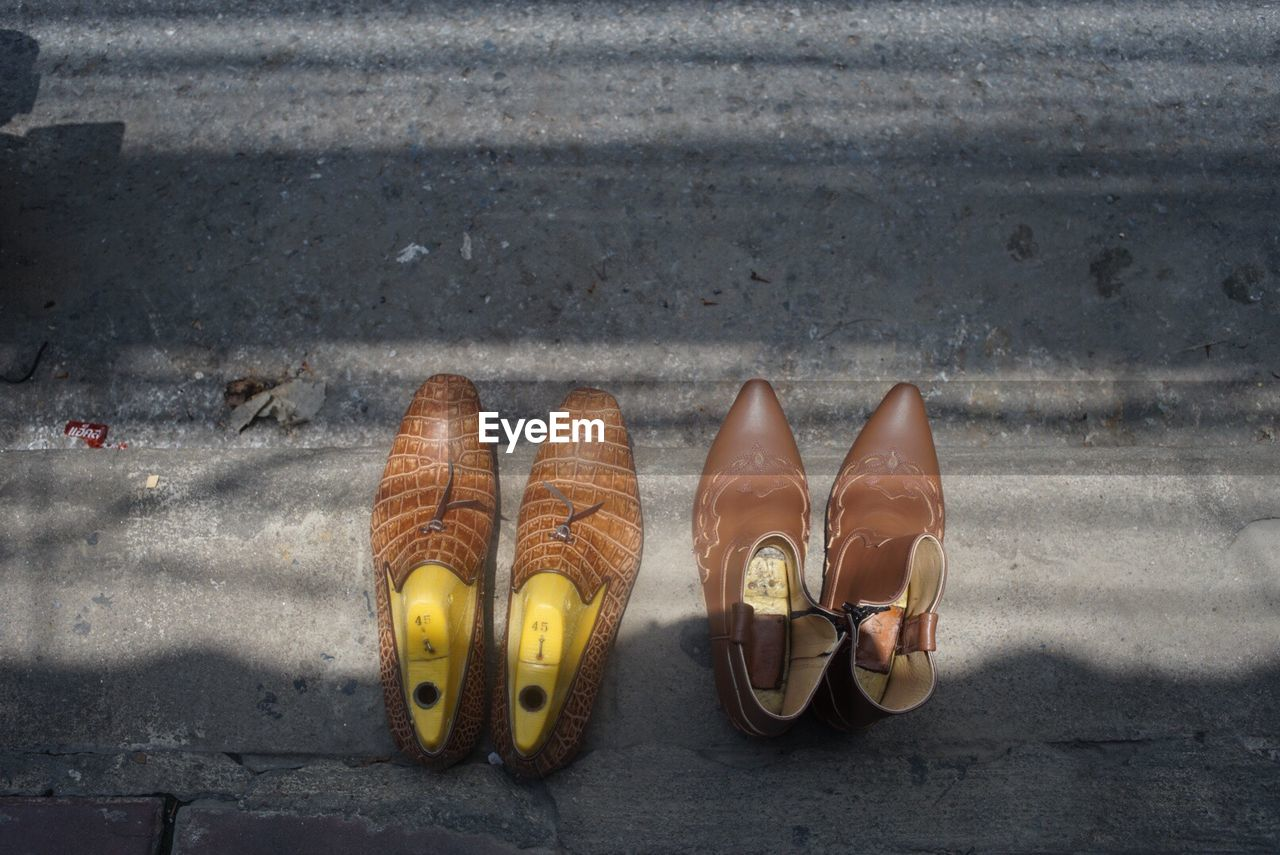 shoe, pair, high angle view, no people, day, sandal, outdoors, yellow, close-up