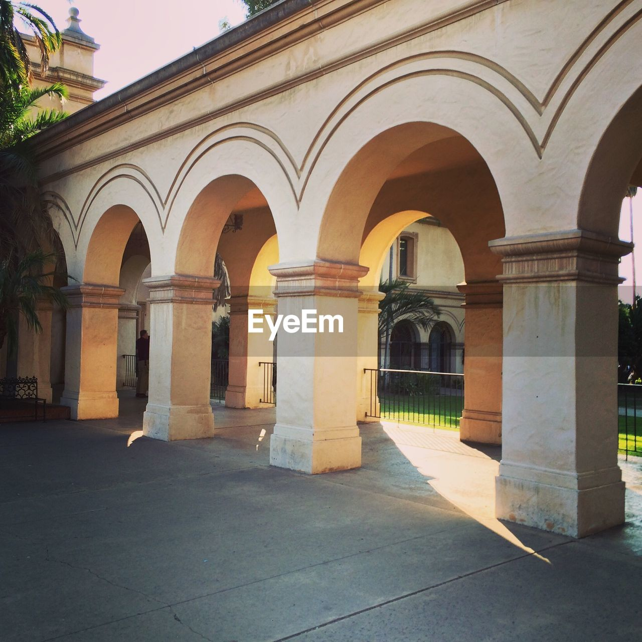 Row of arches and columns outside building