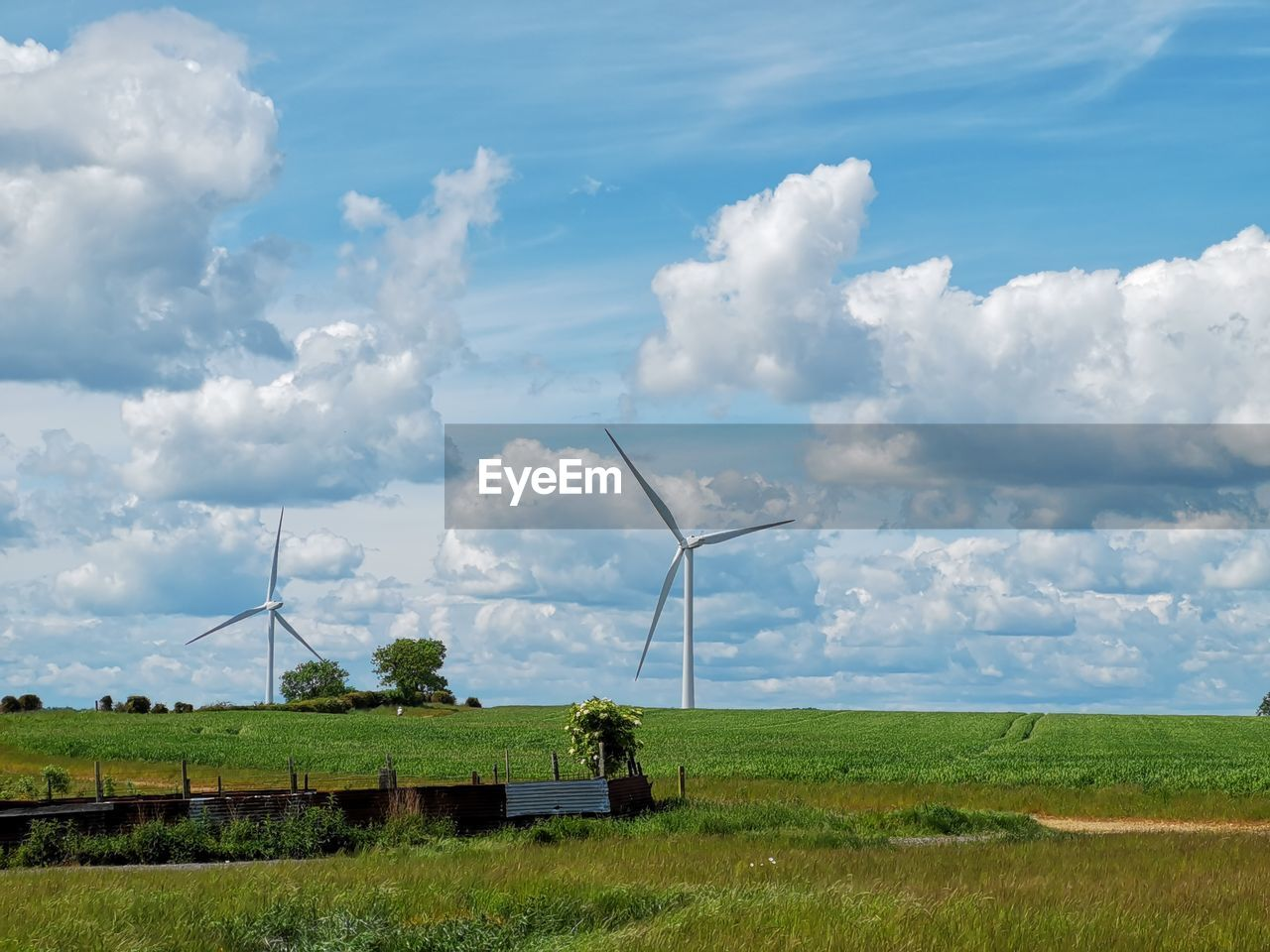 environment, fuel and power generation, renewable energy, cloud - sky, wind turbine, sky, turbine, alternative energy, environmental conservation, landscape, wind power, land, field, nature, rural scene, day, grass, beauty in nature, scenics - nature, plant, no people, outdoors, sustainable resources, power in nature