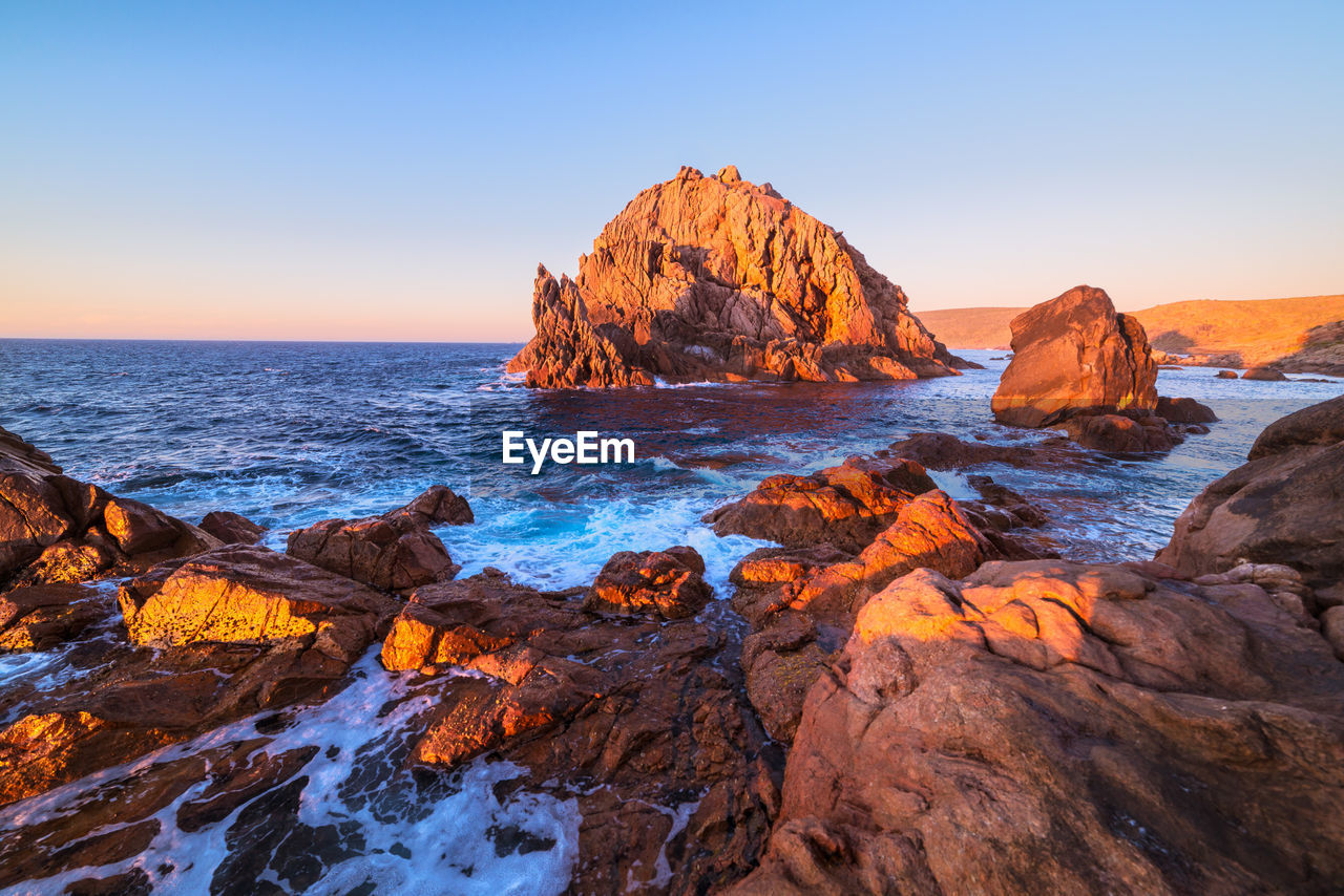 rock, sea, sky, rock - object, water, scenics - nature, beauty in nature, solid, rock formation, tranquility, land, nature, horizon over water, tranquil scene, beach, horizon, non-urban scene, clear sky, no people, outdoors, formation, eroded