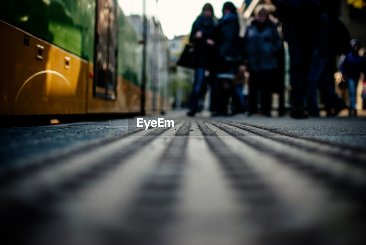 Surface Level Of People Standing By Tramway