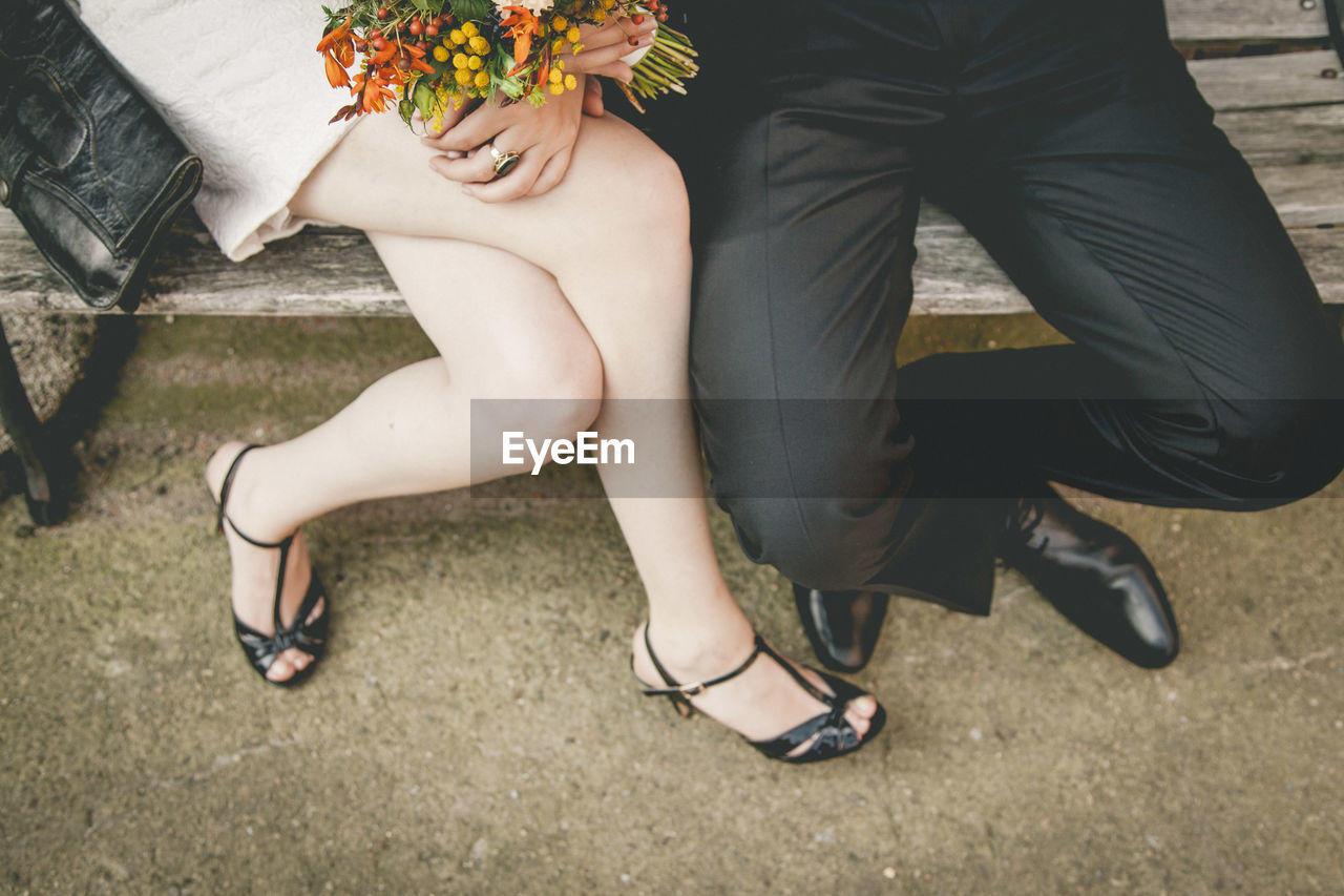 Low section of couple sitting on floor