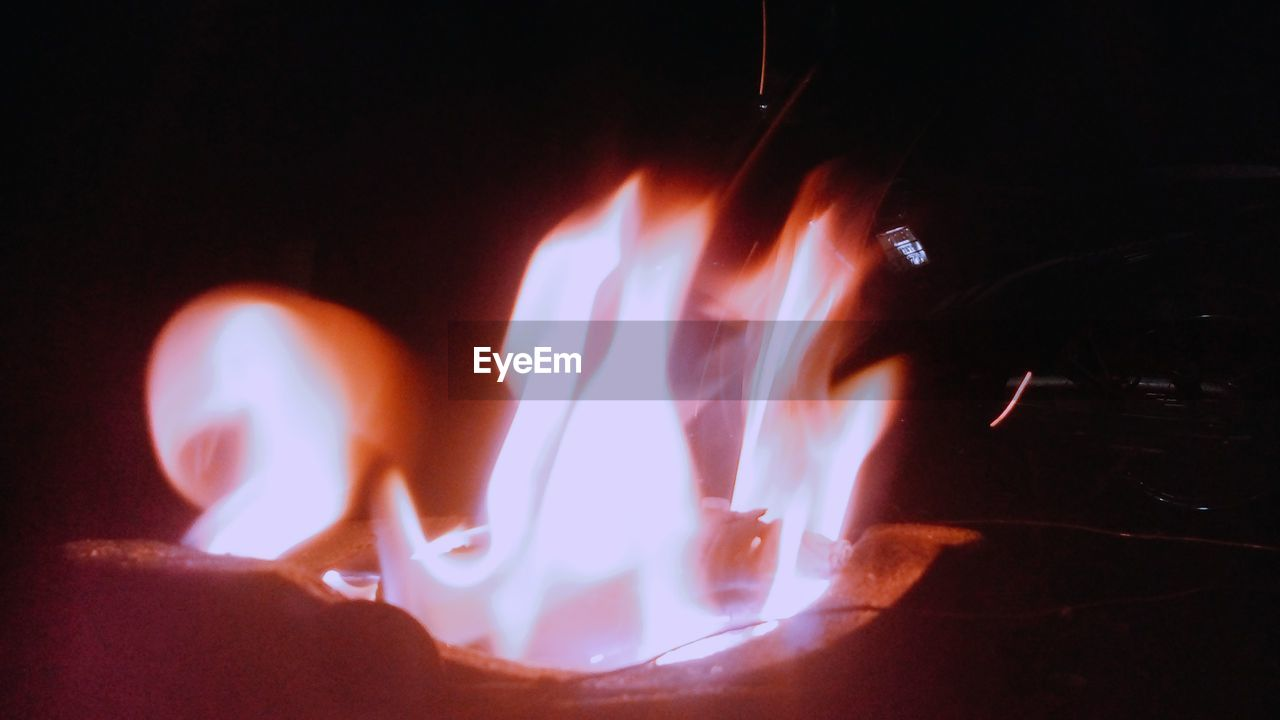 CLOSE-UP OF ILLUMINATED FIRE