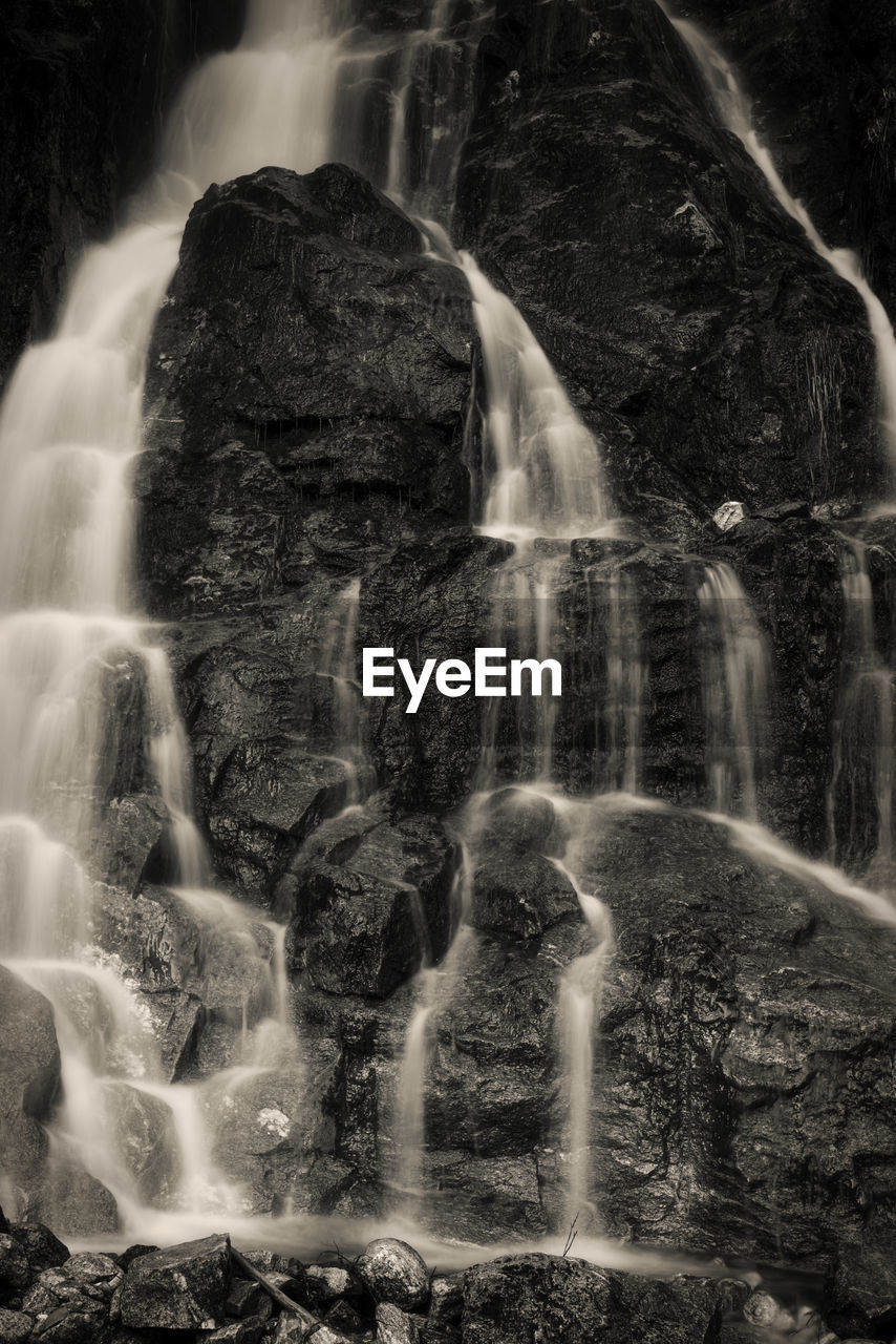 motion, long exposure, waterfall, blurred motion, rock, water, scenics - nature, solid, beauty in nature, rock - object, nature, flowing water, land, no people, outdoors, flowing, non-urban scene, splashing, power in nature, digital composite