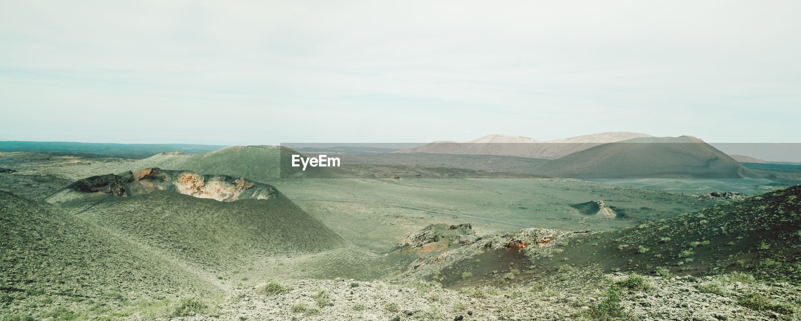Volcanic craters and landscape against sky