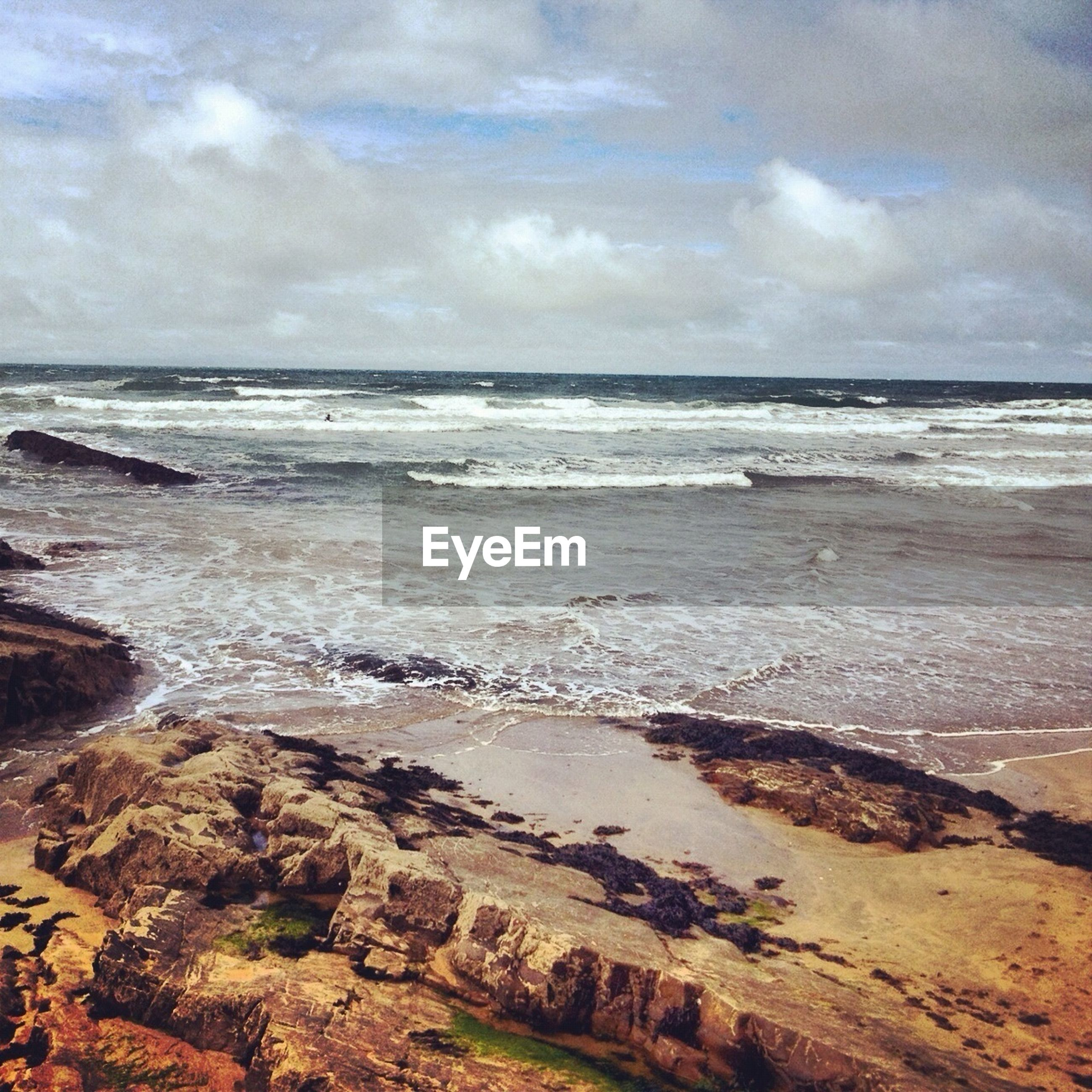 sea, horizon over water, beach, water, sky, shore, scenics, tranquil scene, cloud - sky, beauty in nature, tranquility, wave, nature, cloudy, sand, surf, idyllic, cloud, rock - object, coastline