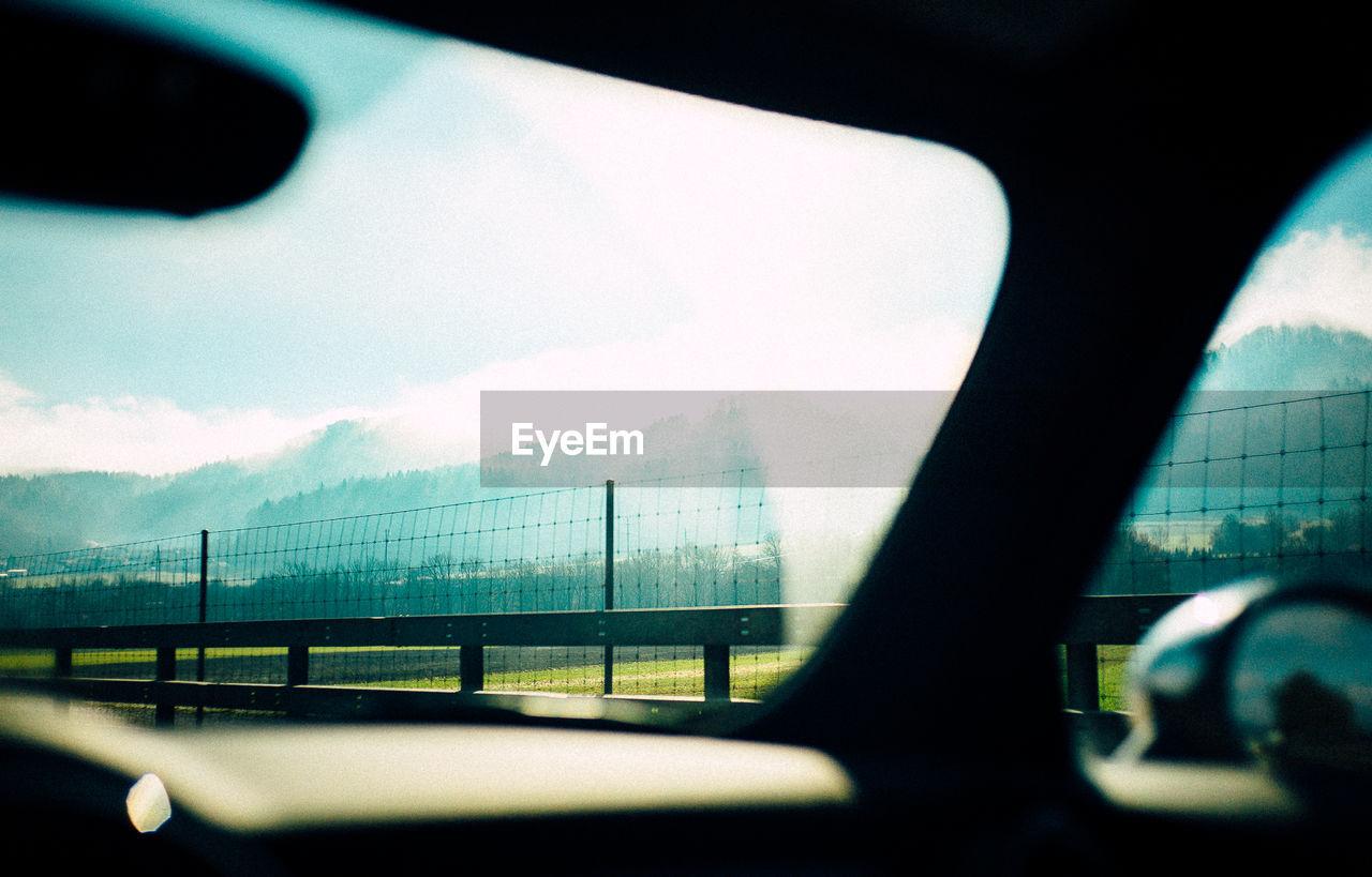 Sky seen through car windshield against sky