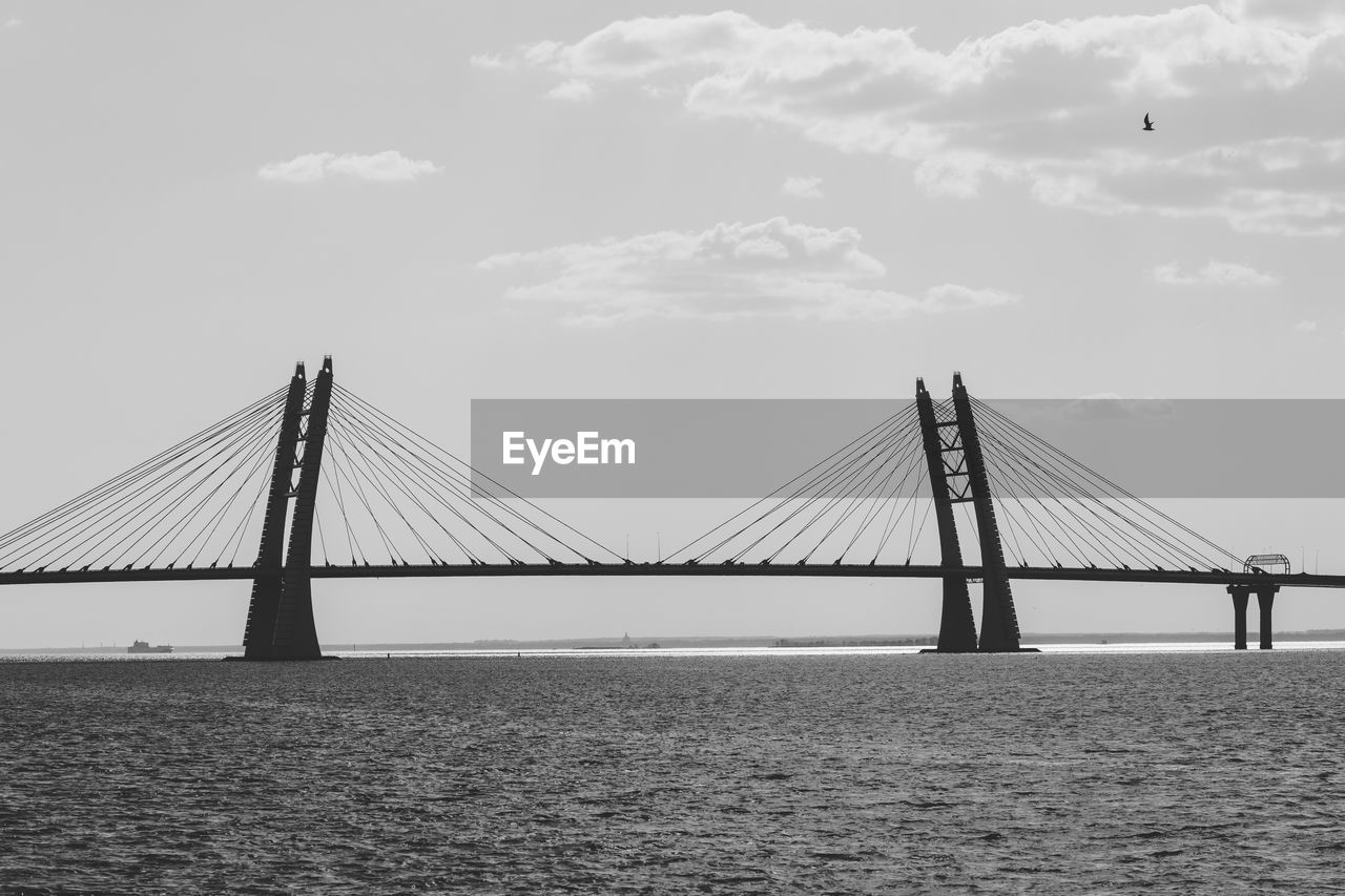 water, sky, bridge, bridge - man made structure, connection, transportation, engineering, architecture, built structure, waterfront, suspension bridge, sea, cloud - sky, nature, day, travel destinations, cable-stayed bridge, long, bay