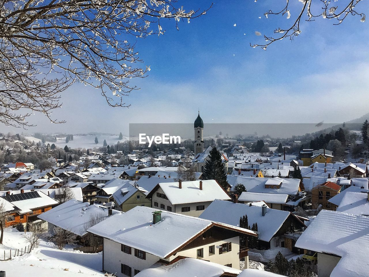 building exterior, architecture, built structure, winter, snow, cold temperature, building, city, sky, nature, tree, roof, day, white color, no people, residential district, house, religion, covering, outdoors, cityscape, townscape