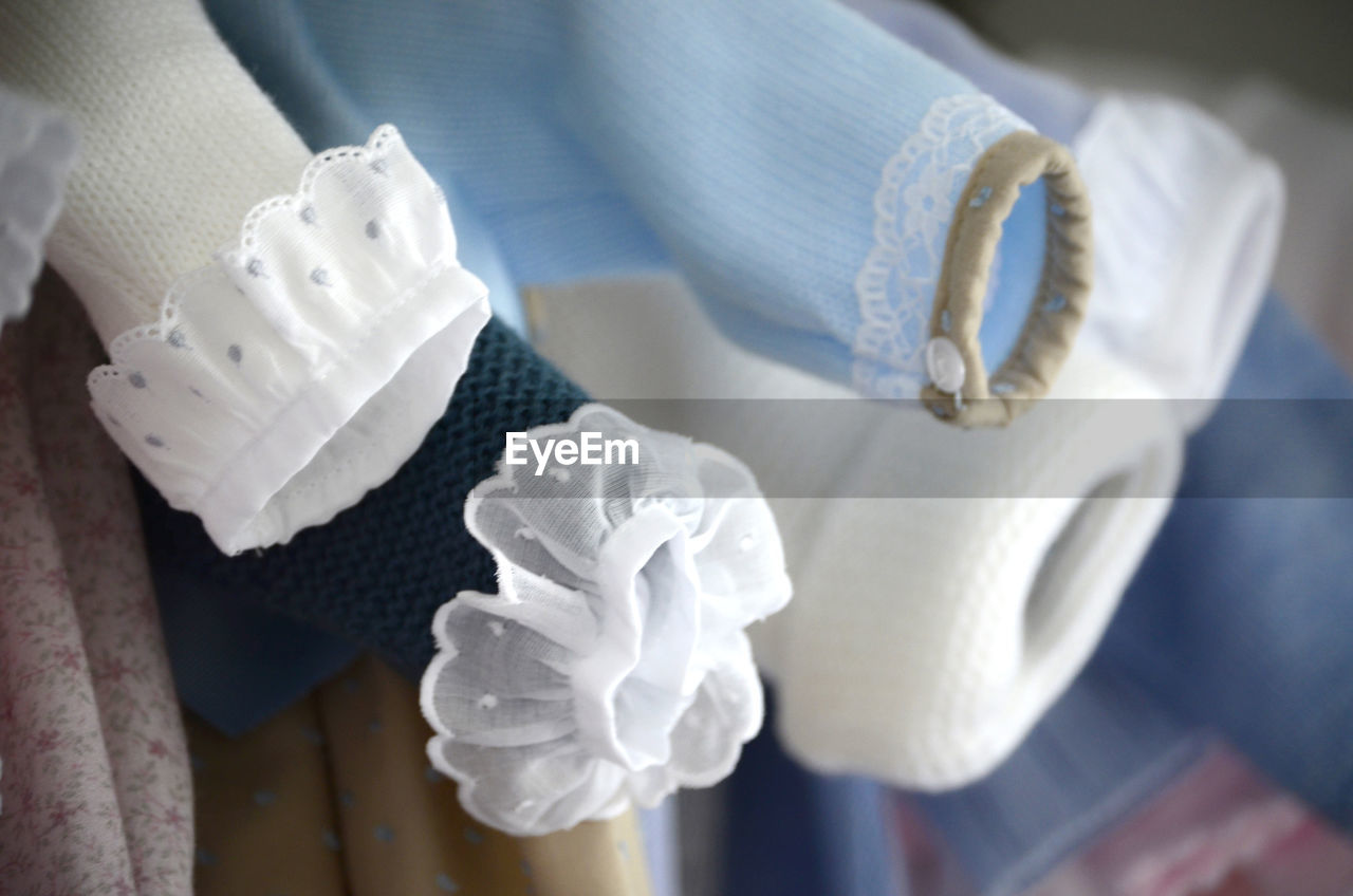white color, indoors, no people, still life, high angle view, hygiene, close-up, towel, sweet, sweet food, pattern, selective focus, clothing, textile, food and drink, indulgence, table, white, cake, glove, temptation, clean