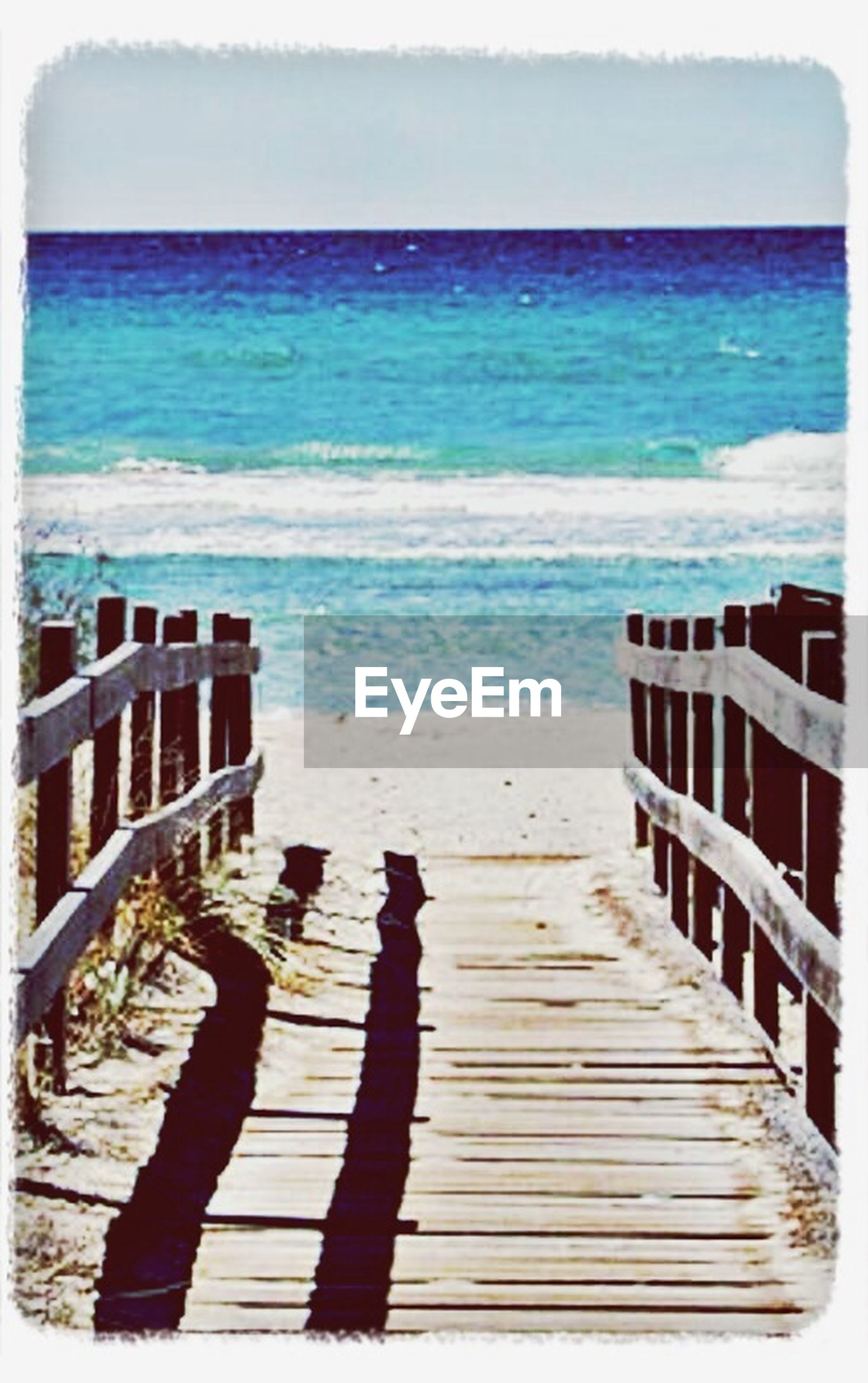 sea, water, transfer print, horizon over water, beach, auto post production filter, shore, wood - material, tranquility, tranquil scene, sand, nature, scenics, sky, day, beauty in nature, pier, blue, railing, sunlight
