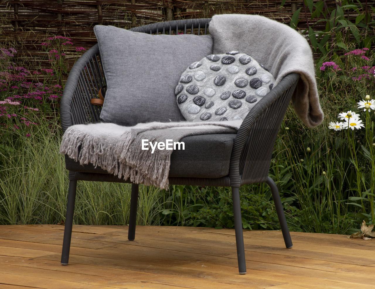 Empty chair on floorboard