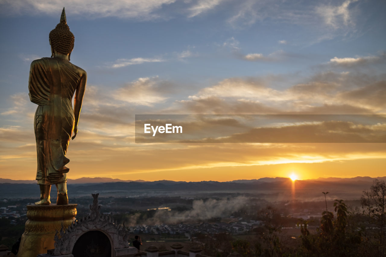 sky, sculpture, statue, sunset, belief, spirituality, religion, art and craft, representation, cloud - sky, human representation, place of worship, nature, architecture, no people, creativity, orange color, built structure, idol