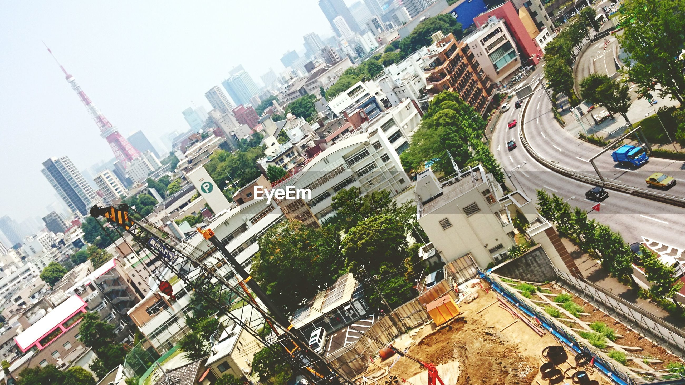 building exterior, architecture, built structure, city, high angle view, residential building, residential district, residential structure, cityscape, street, tree, building, city life, road, clear sky, house, car, day, development, crowded