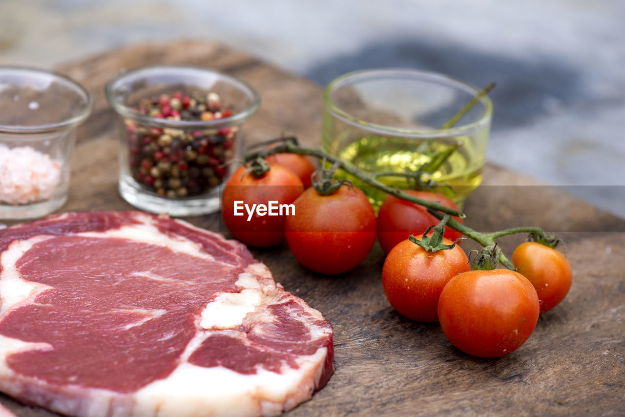 food and drink, food, table, freshness, still life, meat, fruit, red, healthy eating, vegetable, no people, tomato, wellbeing, close-up, focus on foreground, indoors, raw food, selective focus, wood - material, day, tray