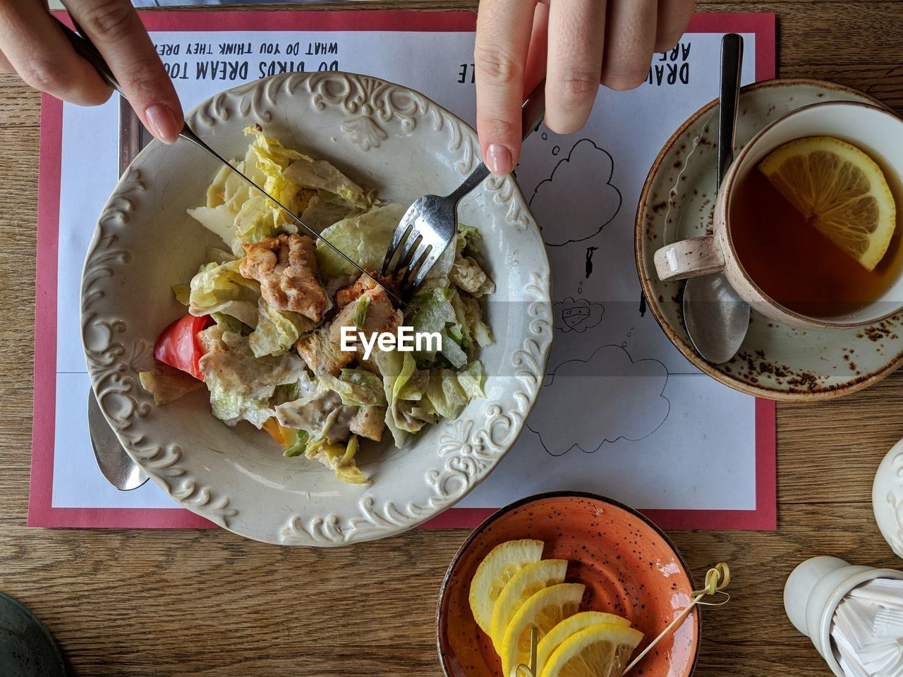 food and drink, human hand, food, hand, freshness, human body part, table, drink, holding, one person, healthy eating, real people, cup, mug, high angle view, refreshment, indoors, directly above, eating utensil, coffee, meal, hot drink, finger, breakfast