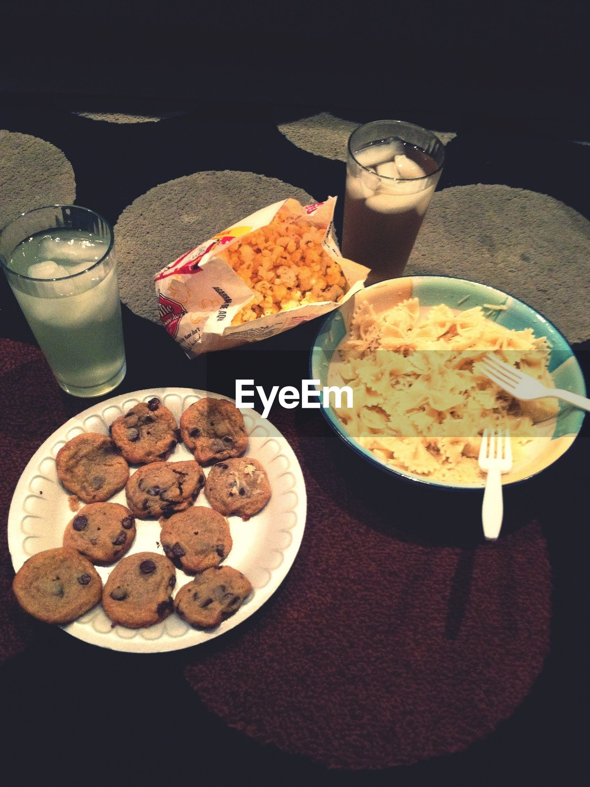 food and drink, food, indoors, freshness, still life, ready-to-eat, table, indulgence, sweet food, high angle view, unhealthy eating, plate, dessert, close-up, temptation, variation, no people, slice, fruit