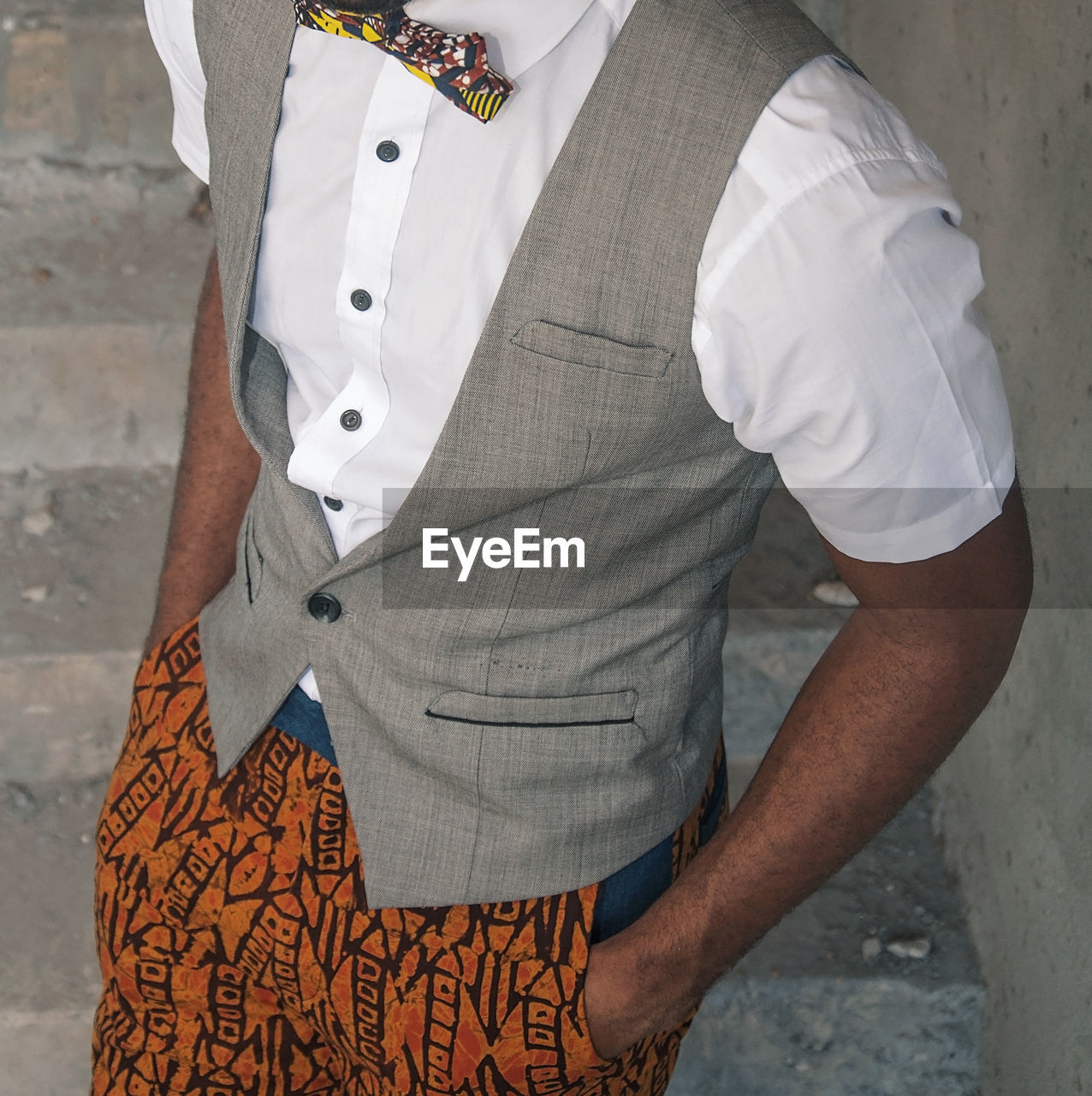 Midsection of man waistcoat while standing on steps