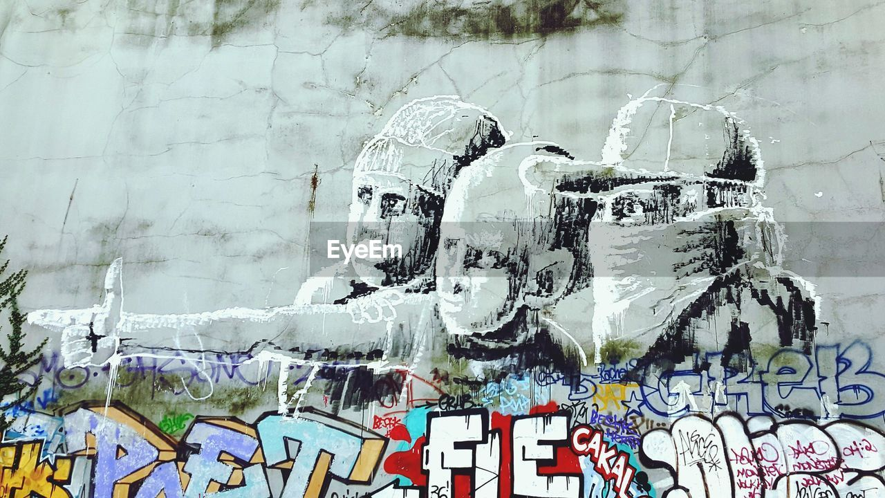 graffiti, creativity, art and craft, human representation, day, wall - building feature, no people, architecture, built structure, building exterior, text, communication, representation, cold temperature, male likeness, digital composite, outdoors, winter