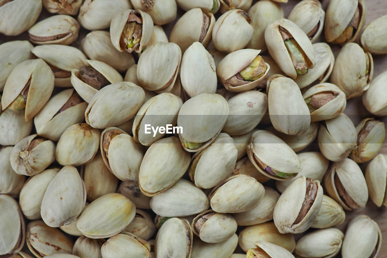 food, wellbeing, food and drink, healthy eating, backgrounds, full frame, large group of objects, freshness, still life, abundance, no people, nut, pistachio, close-up, nut - food, day, indoors, directly above, high angle view, market, snack, temptation