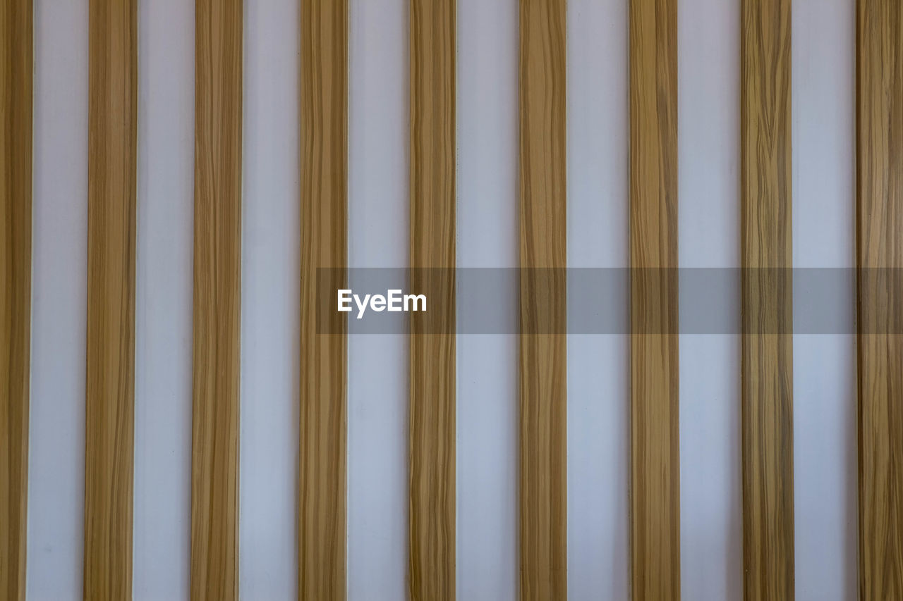 backgrounds, pattern, full frame, no people, yellow, wall - building feature, in a row, close-up, indoors, wood - material, repetition, side by side, blue, industry, architecture, built structure, textured, day, technology, striped, spaghetti, blank