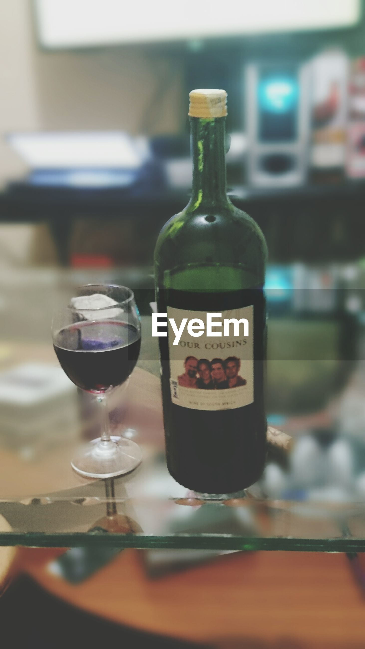 indoors, food and drink, drink, table, refreshment, still life, drinking glass, focus on foreground, wineglass, close-up, glass - material, alcohol, wine, transparent, selective focus, freshness, restaurant, bottle, glass, no people