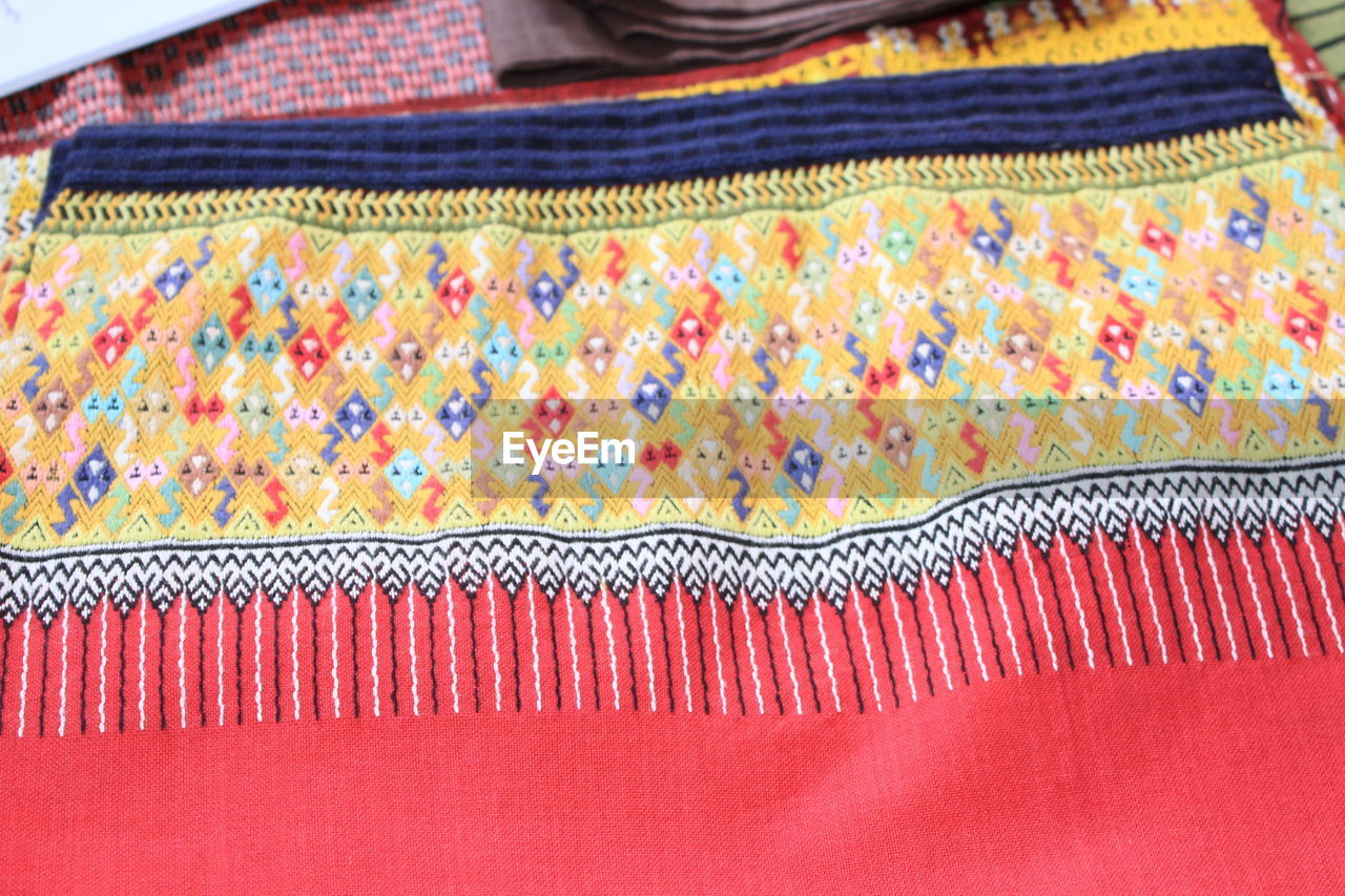 High angle view of multi colored shawl at market stall
