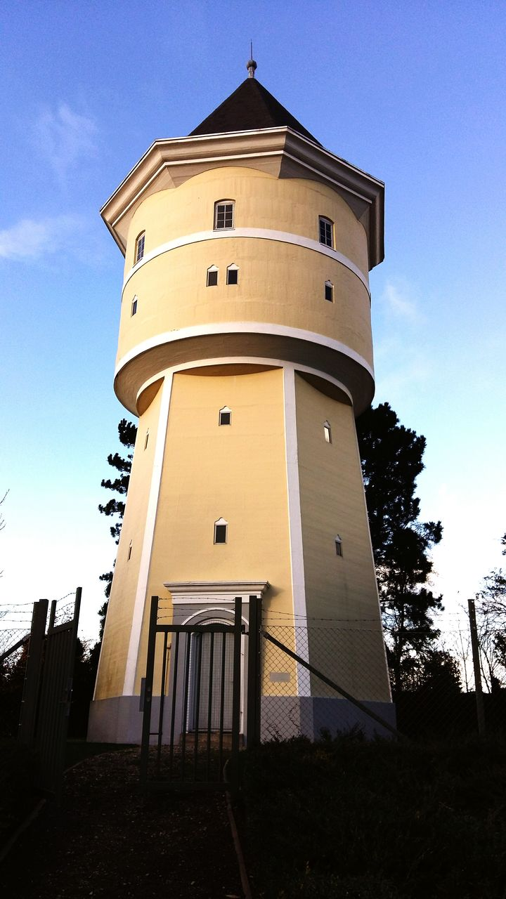 low angle view, architecture, built structure, tower, building exterior, sky, no people, day, outdoors, tree