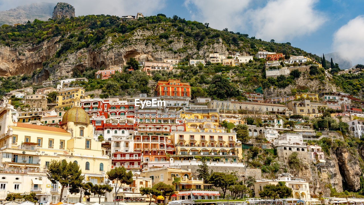 architecture, building exterior, built structure, mountain, city, residential district, building, tree, nature, day, plant, sky, no people, town, outdoors, travel destinations, house, community, townscape, cityscape