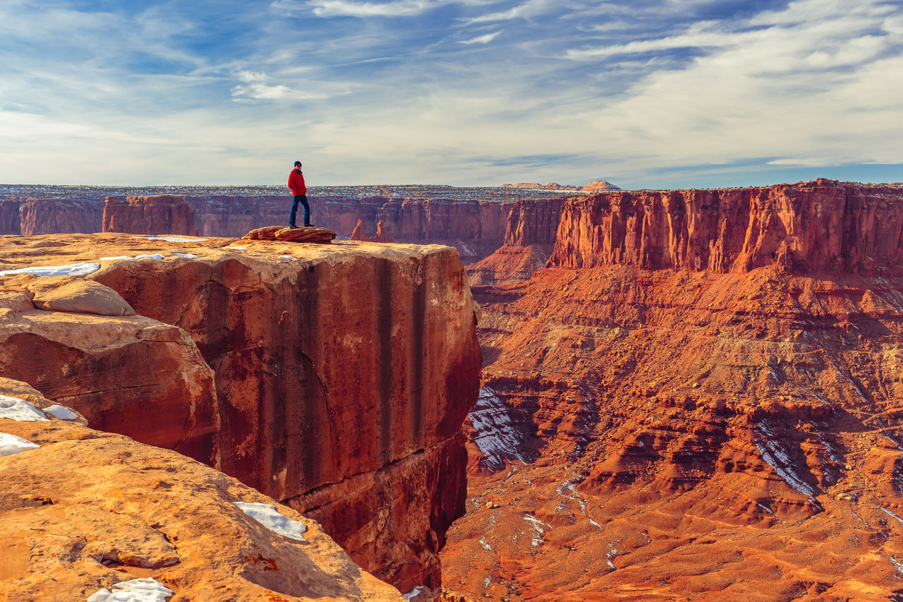 Man Standing On Cliff At Dead Horse Point State Park