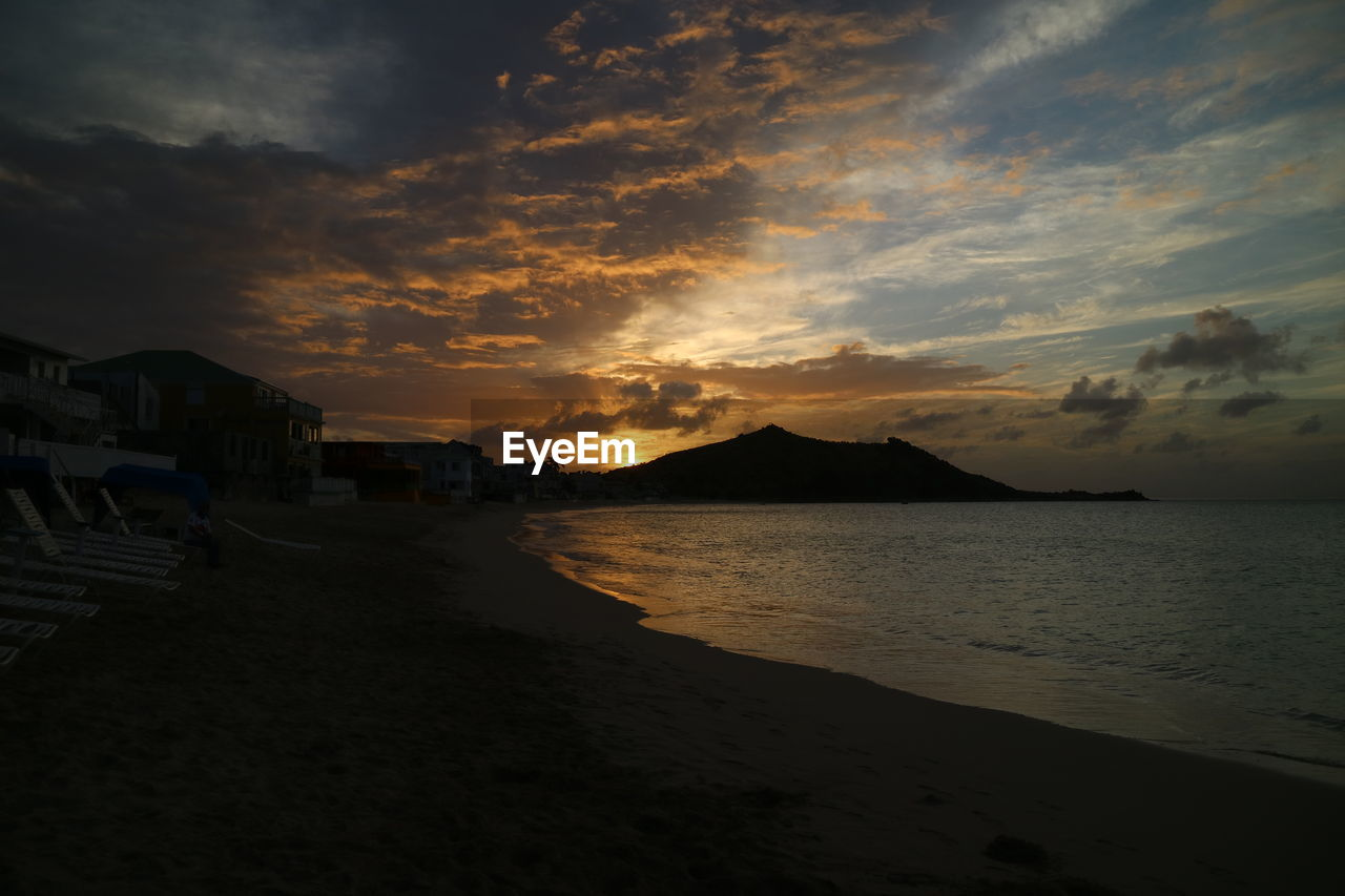 sky, cloud - sky, water, sunset, land, beauty in nature, sea, beach, scenics - nature, tranquility, nature, tranquil scene, mountain, no people, orange color, architecture, idyllic, building exterior, built structure, outdoors