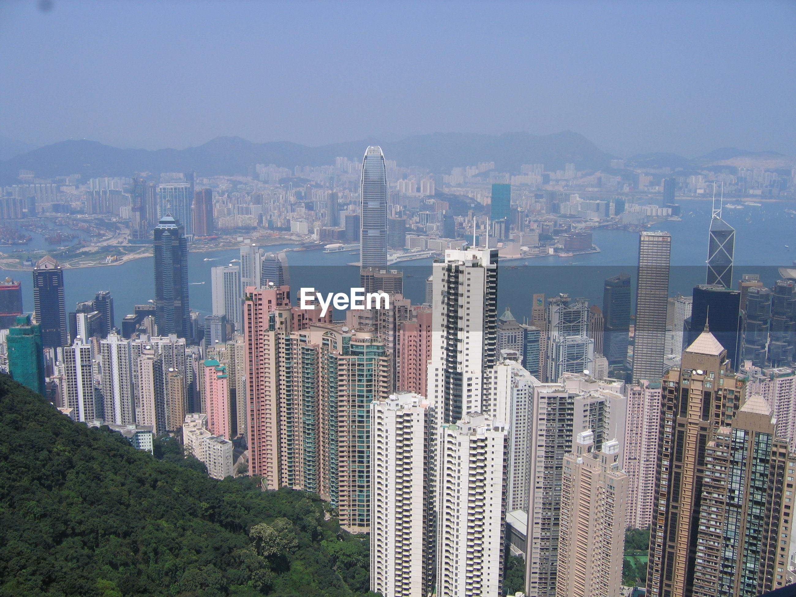 Aerial view of city and buildings against sky