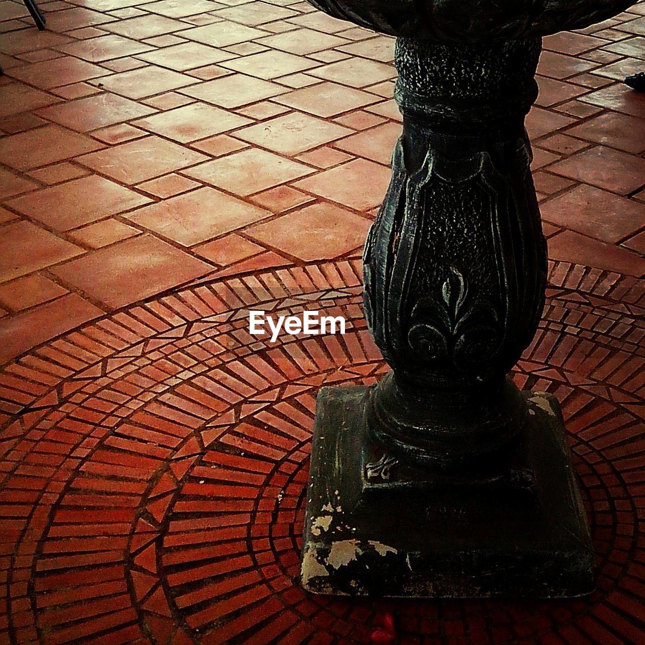 Carved column on floor