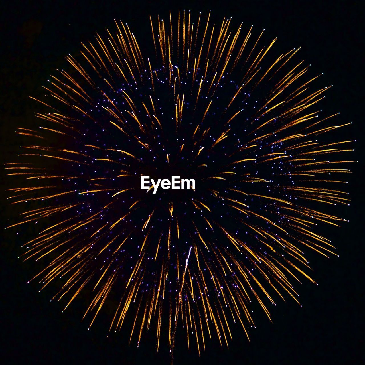 exploding, firework display, night, celebration, firework - man made object, glowing, long exposure, blurred motion, no people, low angle view, arts culture and entertainment, motion, illuminated, outdoors, black background, sky