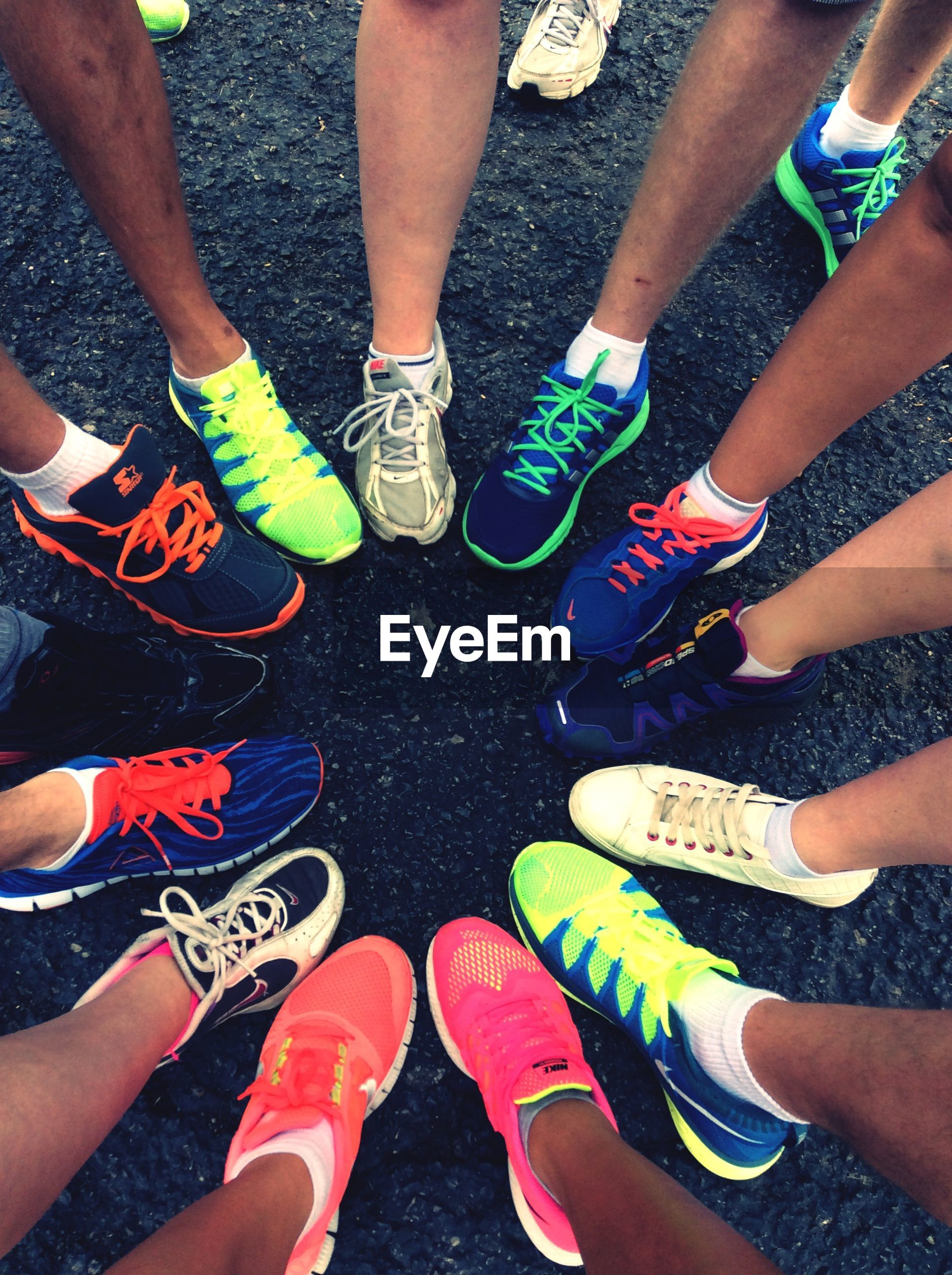 low section, person, lifestyles, leisure activity, high angle view, personal perspective, togetherness, men, shoe, human foot, standing, variation, multi colored, friendship
