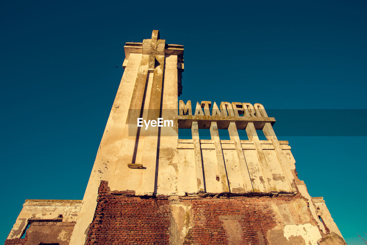 Low Angle View Of Matadero Madrid Against Clear Blue Sky In City