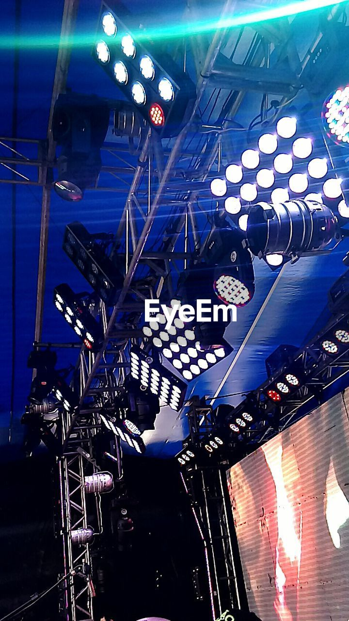 illuminated, low angle view, indoors, lighting equipment, no people, technology, day
