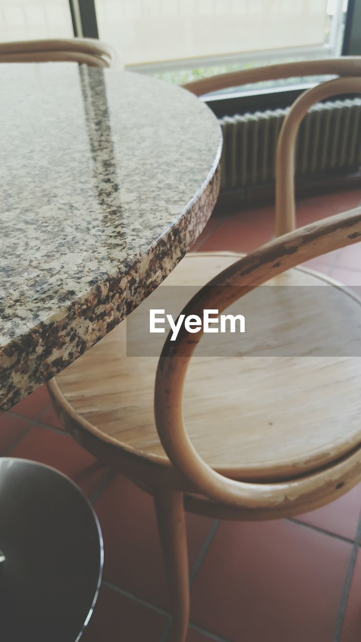 table, no people, chair, focus on foreground, indoors, close-up, day, seat, water, freshness