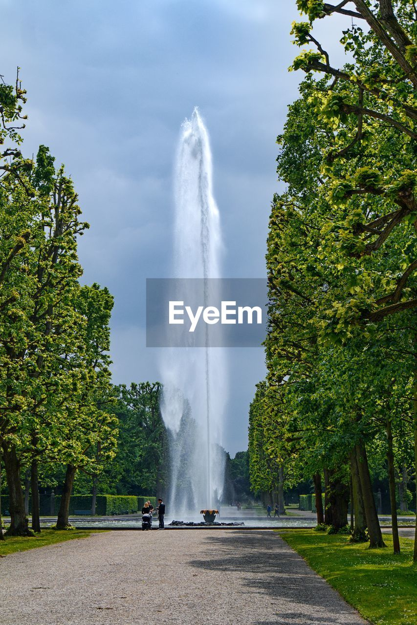 tree, plant, sky, motion, nature, cloud - sky, beauty in nature, spraying, fountain, day, water, green color, long exposure, growth, scenics - nature, direction, no people, transportation, outdoors, flowing water, power in nature