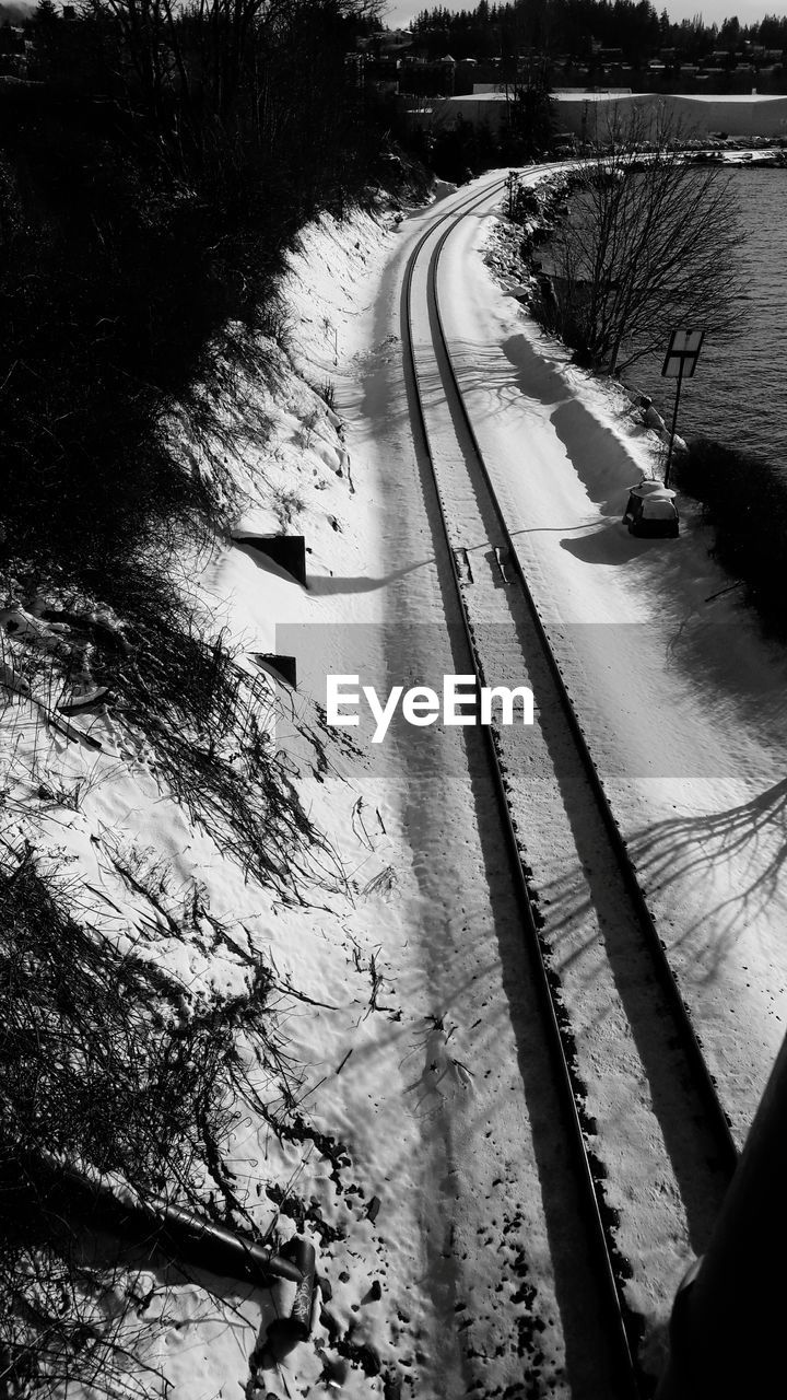 high angle view, transportation, road, nature, no people, winter, outdoors, tree, water, snow, day, cold temperature