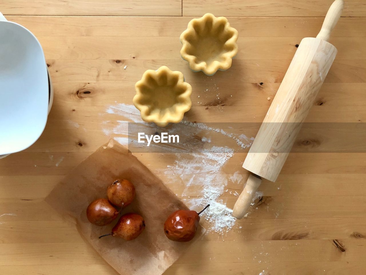 food, food and drink, indoors, freshness, still life, wood - material, table, high angle view, preparation, kitchen utensil, cutting board, flour, no people, preparing food, dough, close-up, wellbeing, rolling pin, raw food, pasta