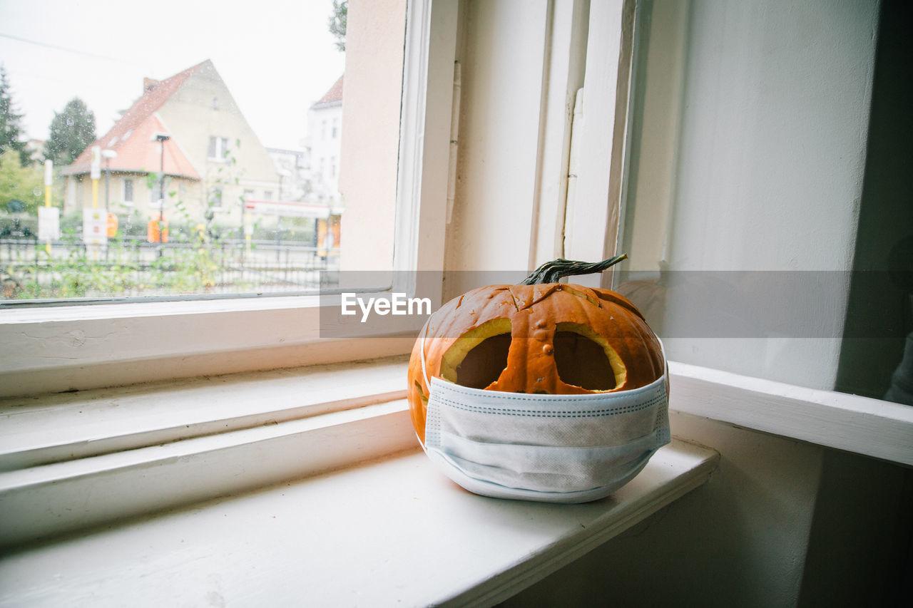Close up of jack o lantern halloween pumpkin with face mask