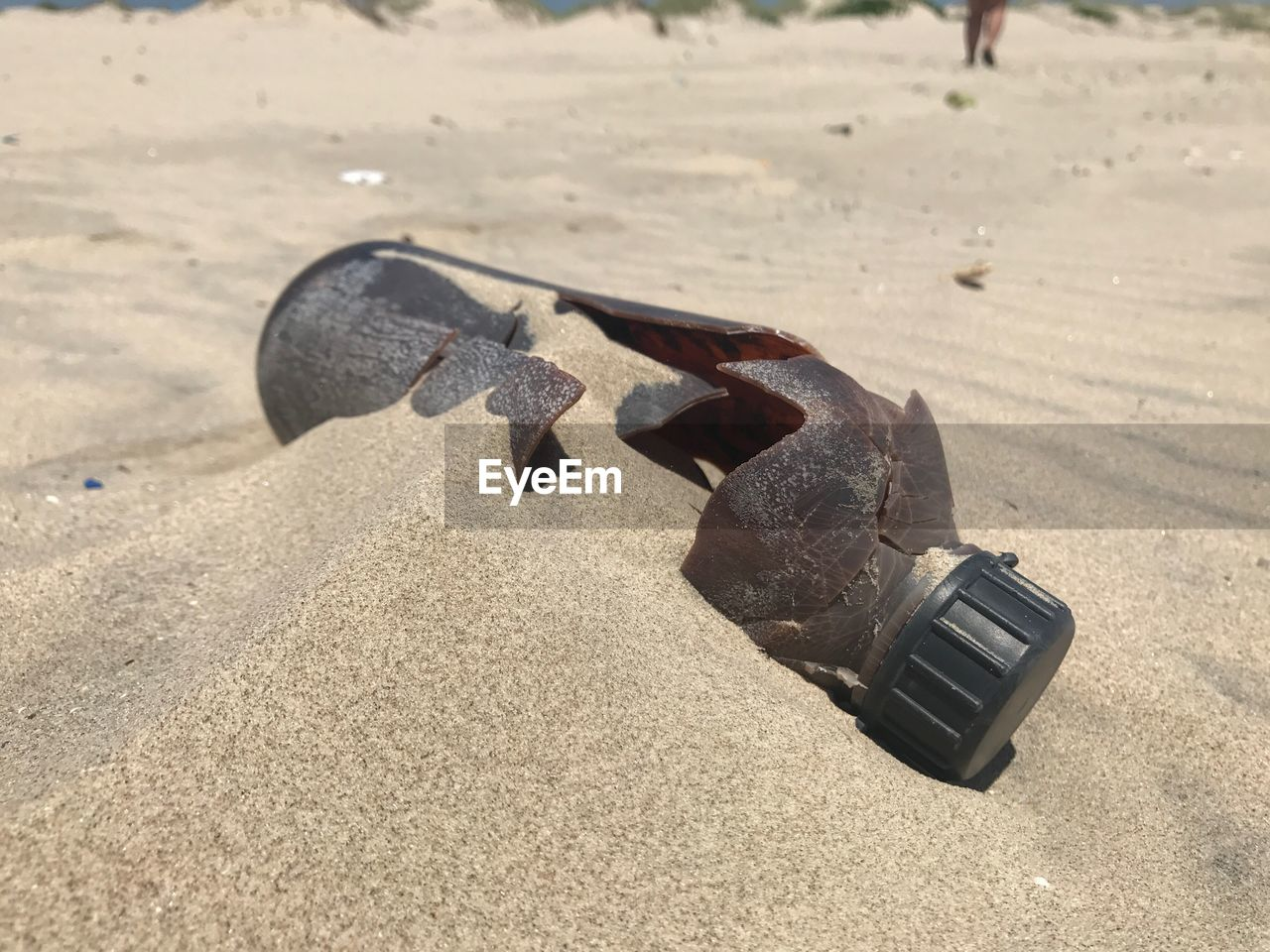 sand, land, sunlight, focus on foreground, beach, metal, shadow, close-up, nature, day, high angle view, sport, no people, still life, sports equipment, outdoors, single object, abandoned, equipment, security