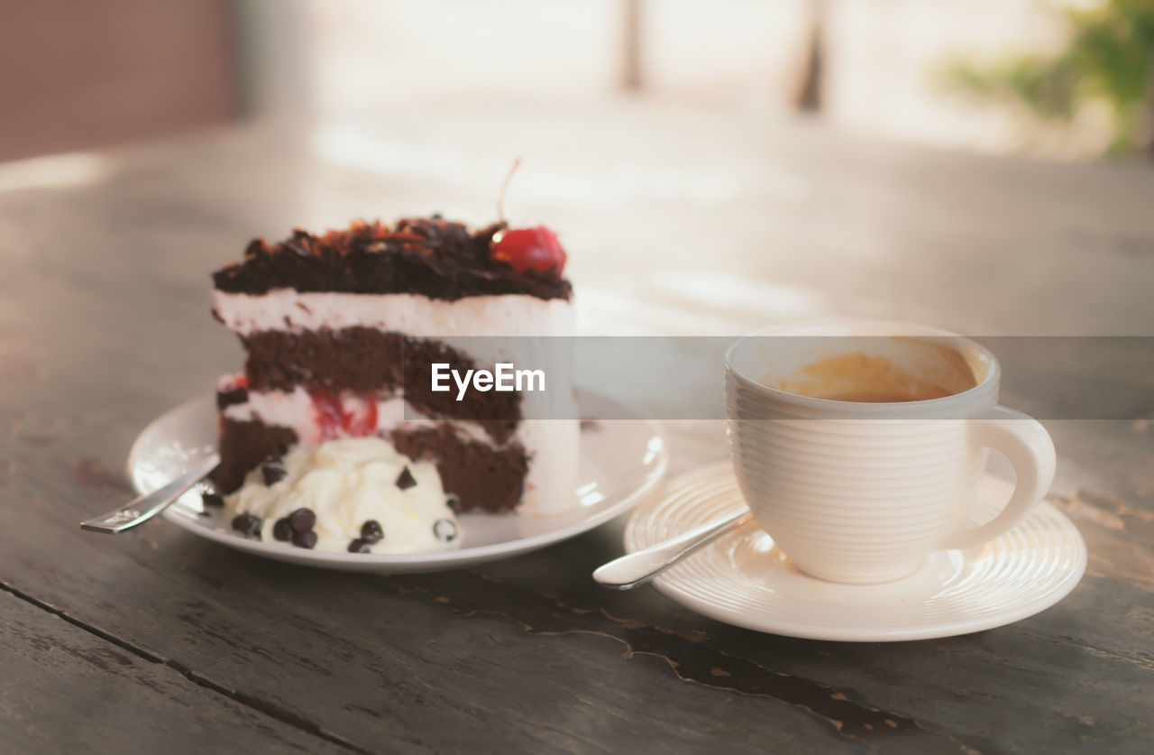 food and drink, sweet food, table, focus on foreground, plate, temptation, indulgence, saucer, indoors, dessert, freshness, no people, food, close-up, drink, ready-to-eat, day