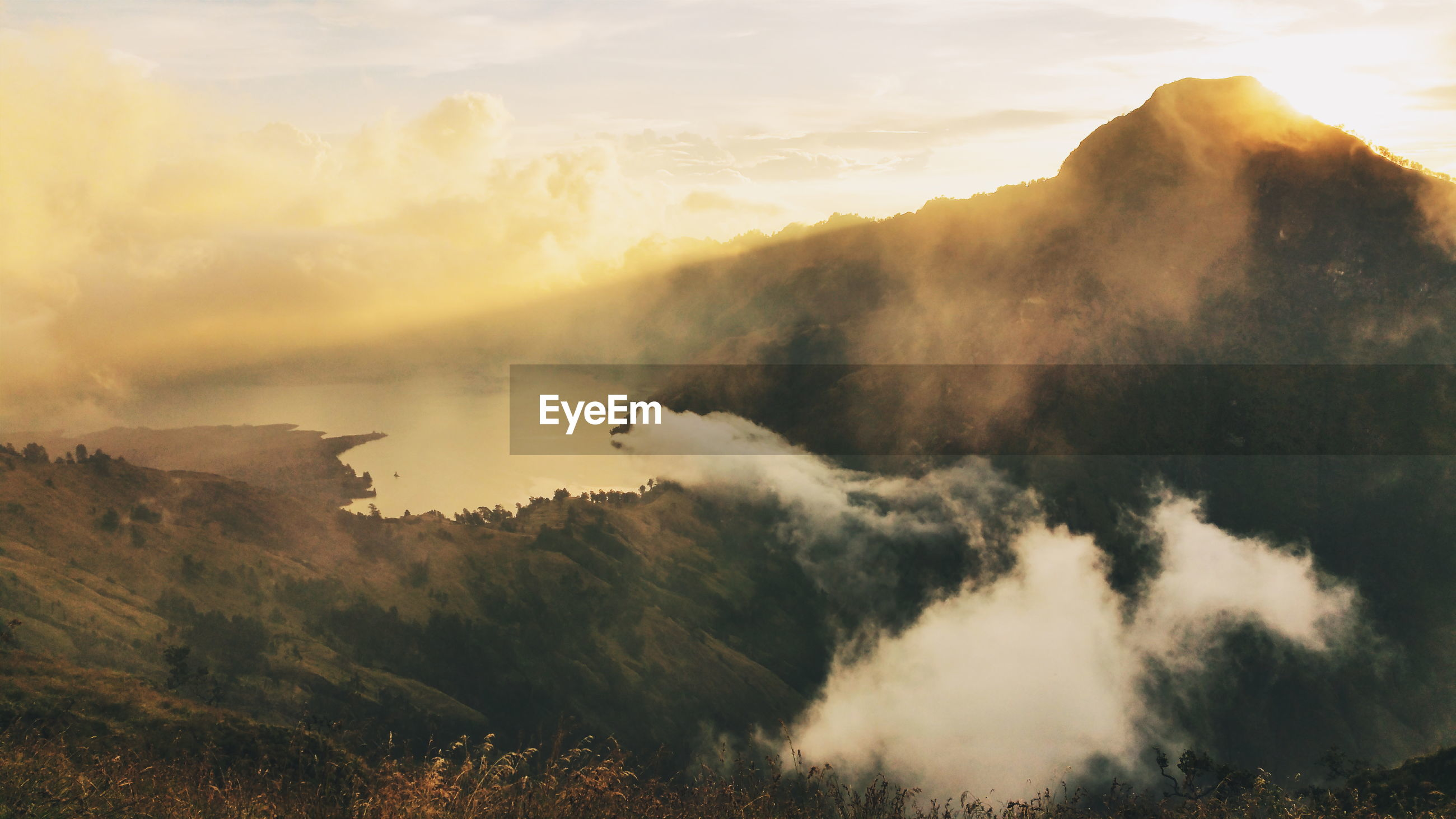 Scenic view of mount rinjani against sky during sunset