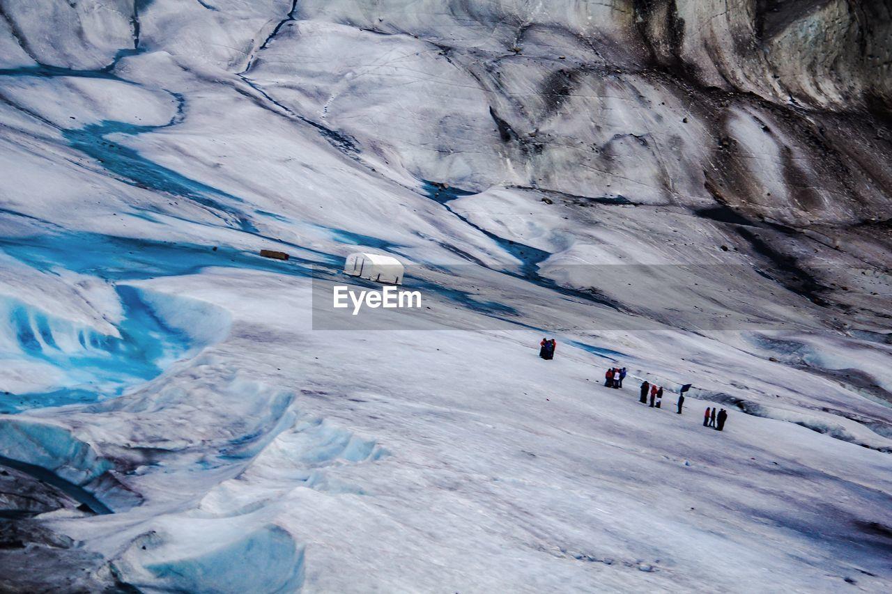 Tilt Shot Of People On Ice At Alaska
