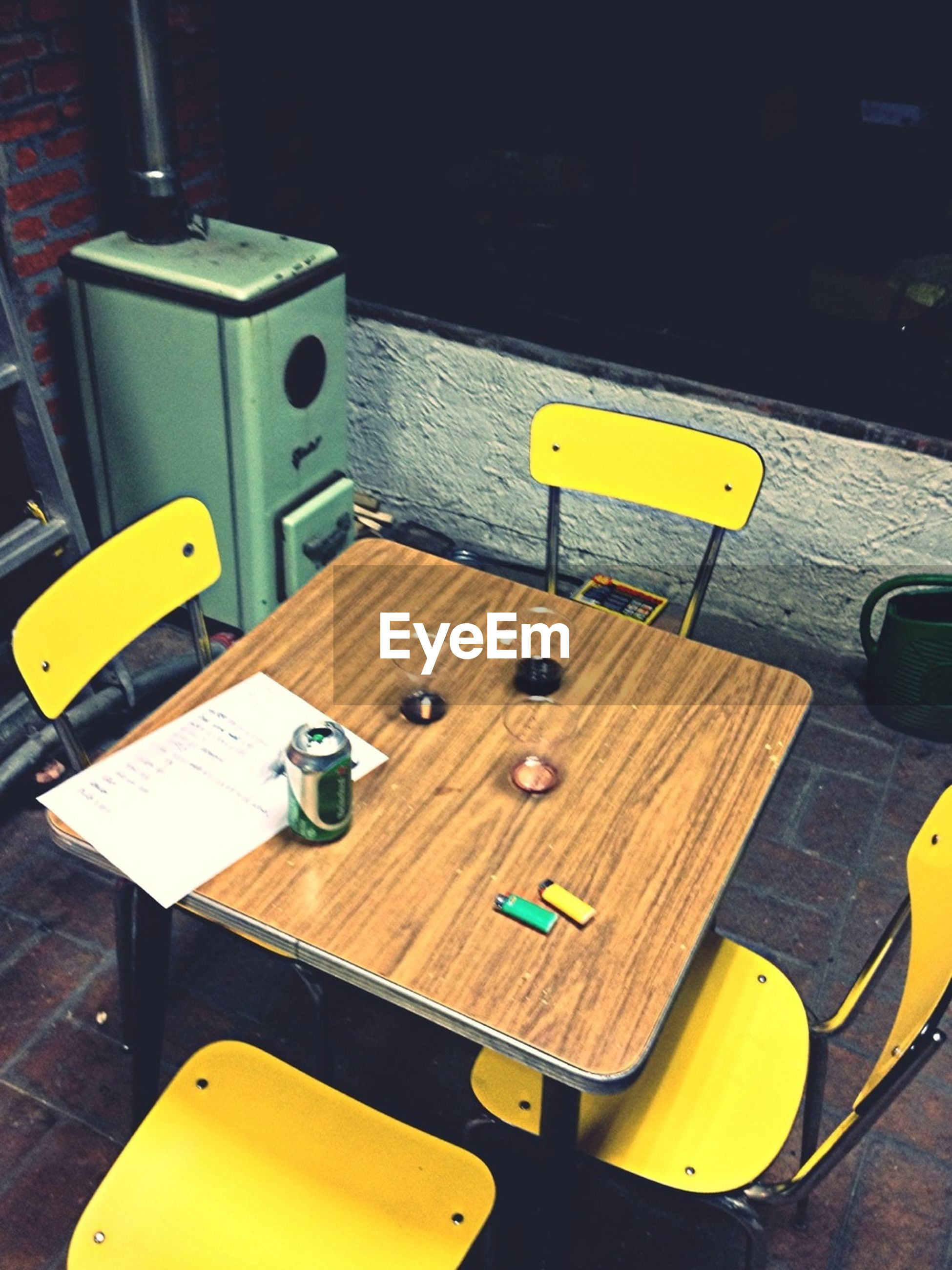 yellow, table, chair, indoors, high angle view, wood - material, absence, empty, day, no people, communication, close-up, still life, bench, seat, in a row, education, sunlight, book