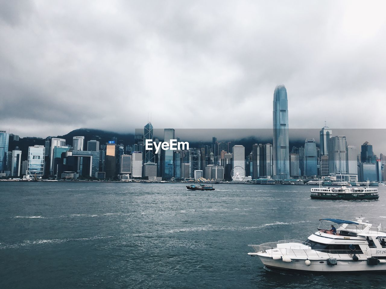 building exterior, cloud - sky, built structure, sky, architecture, water, city, office building exterior, skyscraper, waterfront, urban skyline, building, cityscape, nature, landscape, nautical vessel, sea, transportation, tall - high, no people, modern, outdoors, financial district, yacht, bay, marina